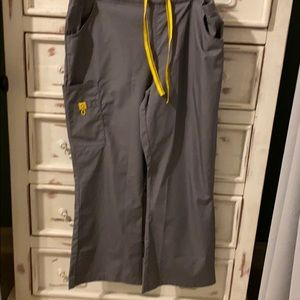 Scrub pants. Gray with yellow string and tag.